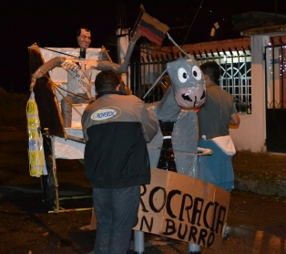 "Figure of a burro pulling a cart full of politicians entitled ""Burrocracia"" or Beaurocracy."